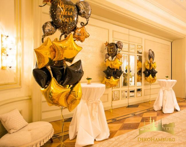 Schwarze und goldene Folienballon Sterne in Traubeform von dekohamburg.de